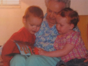 2007 ~ Mary reading to her great-grandchildren