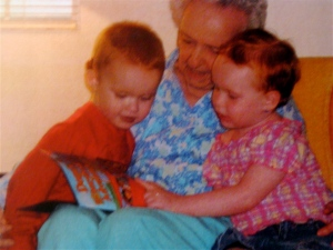 In the early stages of dementia, Mom reading to her great-grandchildren.